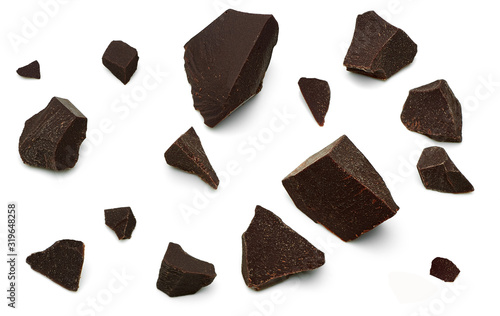 Broken, cracked or crushed dark chocolate parts from top view isolated on white Wallpaper Mural