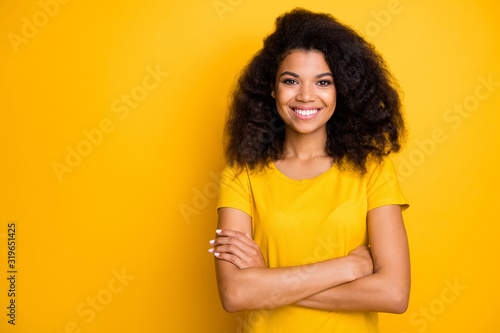 Fototapeta Close-up portrait of her she nice attractive lovely pretty content cheerful cheery wavy-haired girl folded arms isolated over bright vivid shine vibrant yellow color background obraz