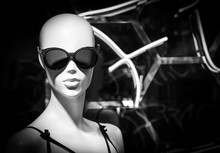 Close-Up Of Mannequin Wearing Sunglasses On Display In Store