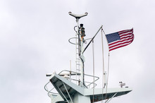 Antennas And Flag Atop A Moder...
