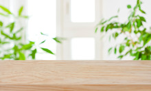 Wood Table Top On Blur Window ...