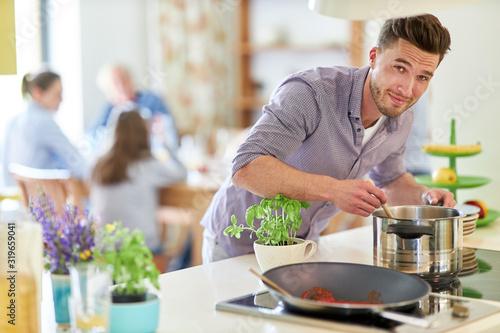 Mann als Hausmann und Hobbykoch beim kochen Canvas Print