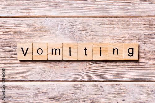 Obraz na plátně vomiting word written on wood block