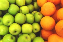 Full Frame Shot Of Granny Smith Apples And Oranges At Market Stall