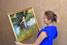 A Woman Holds A Picture In His...