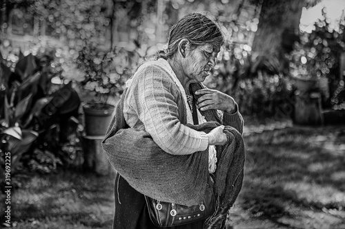 Obraz Poor Woman In Warm Clothes Standing Outdoors - fototapety do salonu