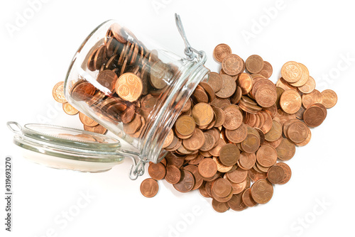 Photo small change euro cent coins pouring out of glass jar isolated on white background, withdrawal of low denomination coins concept
