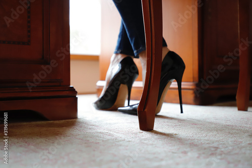 Fotografia, Obraz Low Section Of Woman Standing On Floor At Home