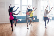 Back View Of Multicultural Dancers Exercising Zumba In Dance Studio