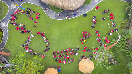 High Angle View Of People Standing On Field At Park