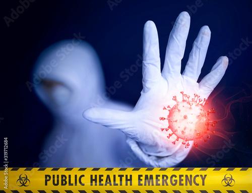 Fototapeta Public health emergency. Quarantine medic trying to stop an epidemic outbreak. Collage of photo and bloody 3D model of novel Chinese coronavirus. Yellow tape and Biohazard symbols. Mixed media image obraz