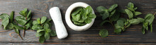 Mortar, Pestle And Mint On Wooden Background, Top View