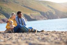 Loving Couple Sitting On Sand ...