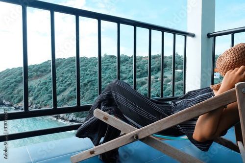 Papel de parede Side View Of Woman Relaxing On Chair At Balcony