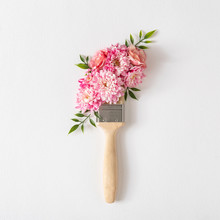 Flowers Composition. Creative Layout Made Of Pink And White Flowers And Paint Brush On White Background. Flat Lay, Top View.