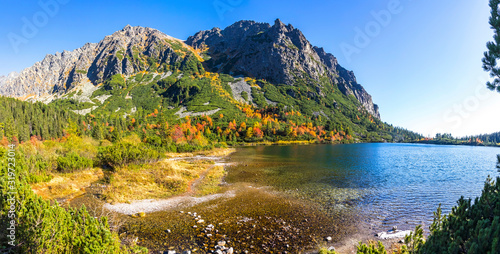 Fototapeta Panoramic picturesque view of mountain glacier lake Poprad (Slovak: Popradske pleso) in High Tatras, Slovakia. Sunny autumn day obraz