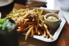 Close-Up Of French Fries With Sauce