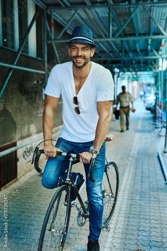 mata magnetyczna Trendy hipster guy riding on bicycle on street