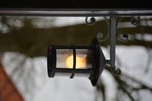 Illuminated Lamp Against Bare Tree