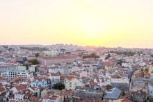 Lisbon City Covered In Buildings With Red Roofs During The Sunset In Portugal