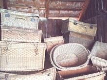 Homemade Wicker Baskets Against Wooden Wall