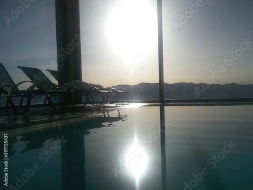 Obraz na plátně Sun Loungers By Swimming Pool