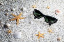 Sunglasses On Sand Beach Borde...