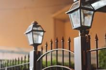 Lamp Posts On Metallic Fence