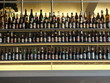 Low Angle View Of Various Alcohol Bottles In Shelves