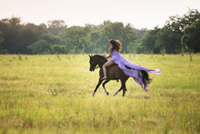 Girl Riding Horse In Dress