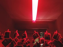 Photographs Hanging Under Illuminated Fluorescent Light In Darkroom