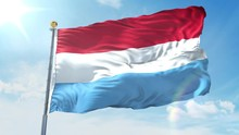 Luxembourg Flag Waving In The Wind Against Deep Blue Sky. National Theme, International Concept. 3D Render Seamless Loop 4K