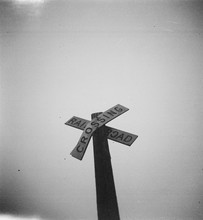 Low Angle View Of Railroad Crossing Sign Against Clear Sky