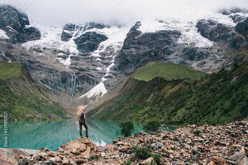 Female tourist enjoying freedom lifestyle and amazing scenery of mountains cover Canvas Print