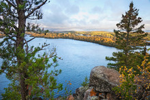 Rocky Overlook Of Northern Minnesota Lake With Pines And Birch During Autumn