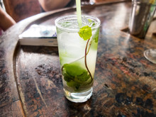 Cold Drink With Mint Leaf On Wooden Table