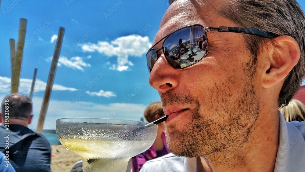 Fototapeta Close-Up Of Man Having Drink On Sunny Day