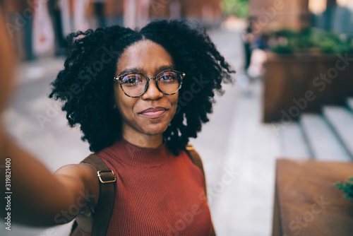 obraz dibond Young black woman smiling and taking selfie
