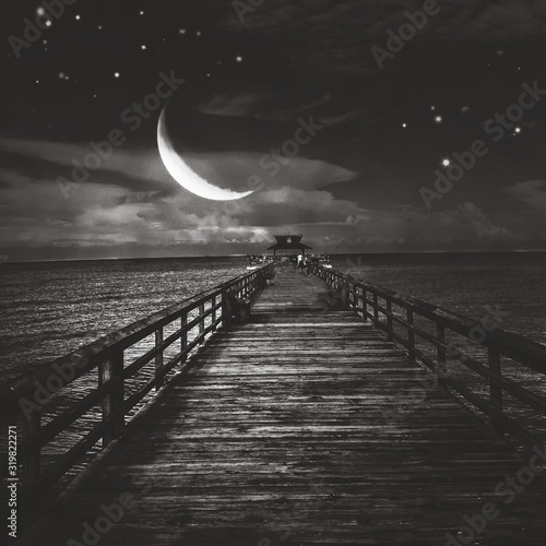 Canvas Print Crescent Moon Over Sea With Wooden Pier