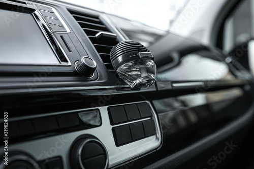 Stylish air freshener clip attached to car ventilation Canvas Print
