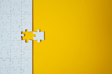White Jigsaw Puzzle On Yellow ...