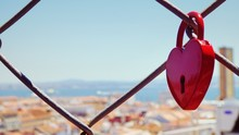 Close-Up Of Heart Shape Padlock On Chain Link Fence