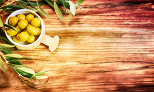 Olives On The Wooden Table