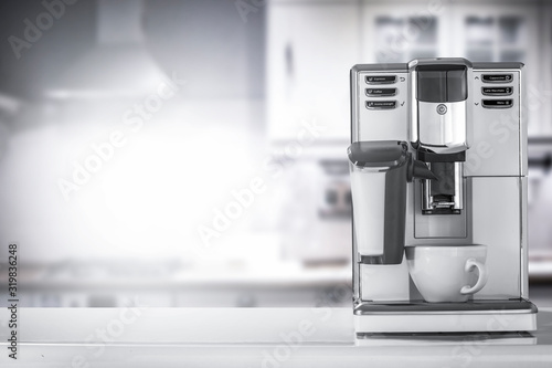 Fototapeta White coffee machine in kitchen interior and free space for your decoration.  obraz
