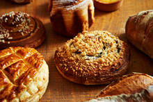 Various Bread On Wooden Table