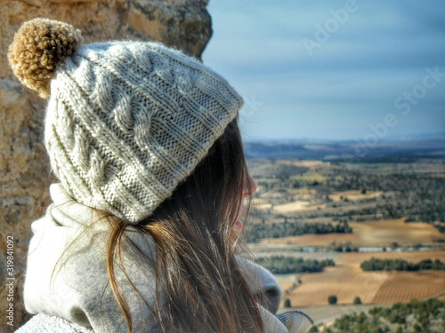 Close-Up Of Woman By Rock Formation Against Sky