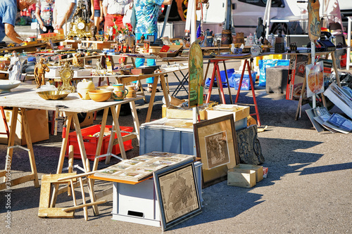 Photo Ascona, Switzerland - August 23, 2016: Various goods for selling at the counter in the flea street market in Ascona, Lake Maggiore, Ticino canton, Switzerland