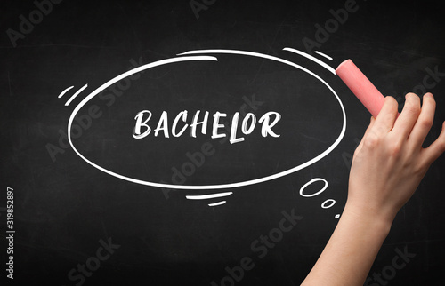 Photo Hand drawing BACHELOR inscription with white chalk on blackboard, education conc