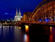 Hohenzollern Bridge Over Rhine River By Cologne Cathedral In City