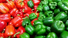 Full Frame Shot Of Red And Green Bell Pepper For Sale In Market